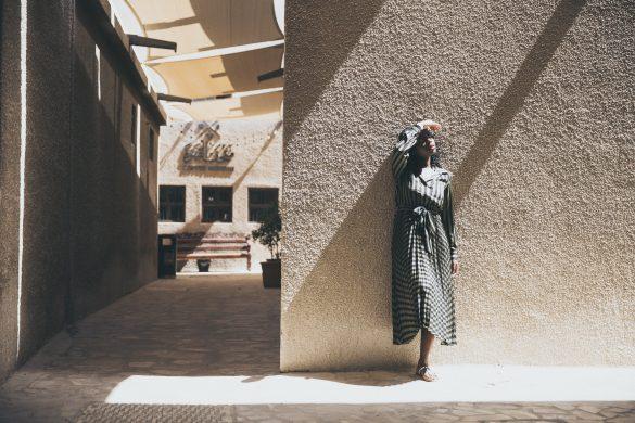 lady standing in an alley in bastakiya