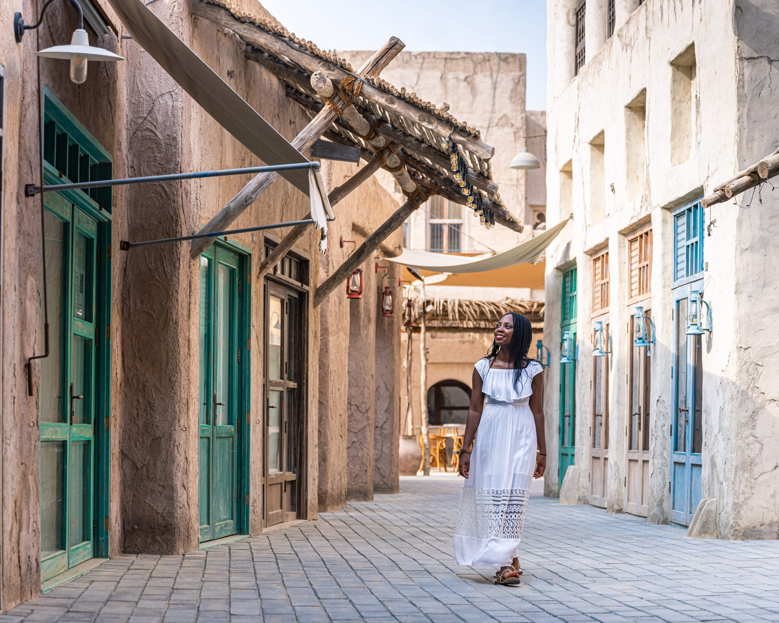 Ashleigh walking through the alley ways at Al Seef, Old Dubai